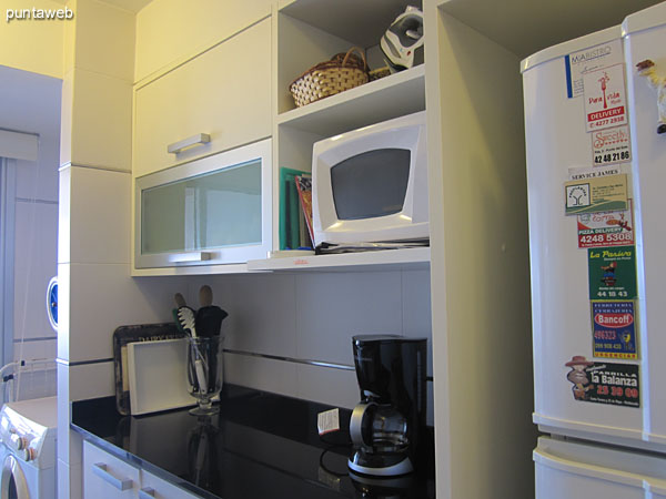 Disposition of the microwave oven and other appliances in the kitchen.