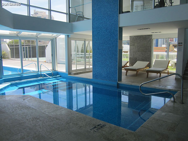 Building amenities: heated pool located to the north side of the building.<br><br>At the bottom of the image the outdoor pool for adults and outdoor pool for children are appreciated.