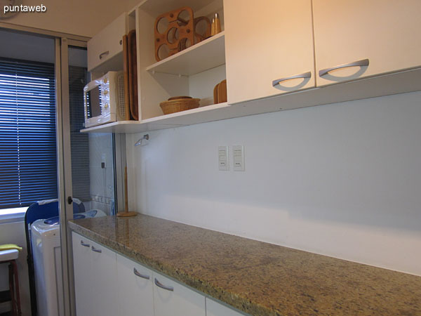 Kitchen. Fitted with low furniture and countertops.<br><br>It features an outdoor window in existing laundry space below on the north side of the building.