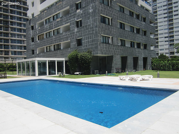 Heated pool. Located on ground floor in sector amenities behind the lobby.