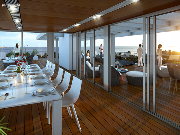 Renderizado del espacio de barbacoa y terraza común en el último piso.