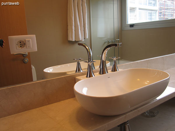 Detail of faucets and fixtures in the bathroom in the master bedroom suite.