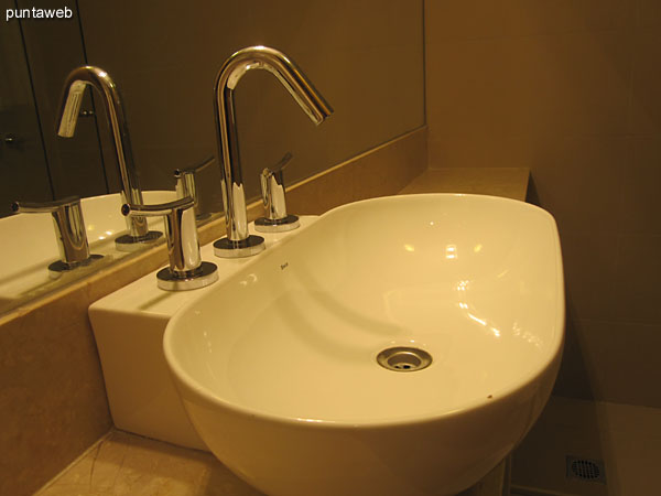 Detail of faucets and fixtures in the bathroom in the third bedroom suite.