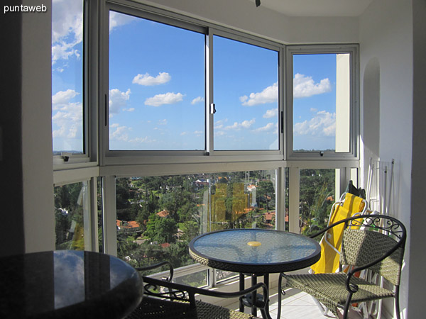 View to the northwest from the window of the dining space.<br><br>In the spotlight Punta Shopping parking.