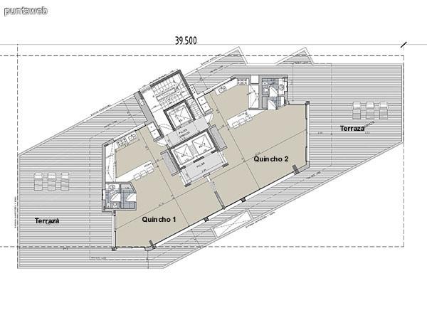 Azotea del edificio con dos quinchos y terrazas exteriores.