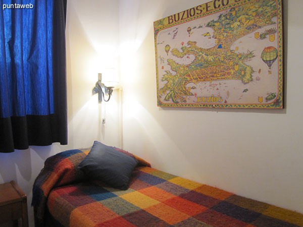 hird bedroom. Located on the building and furnished with two single beds.