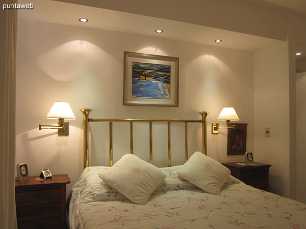 Detail of the double bed in the main bedroom.