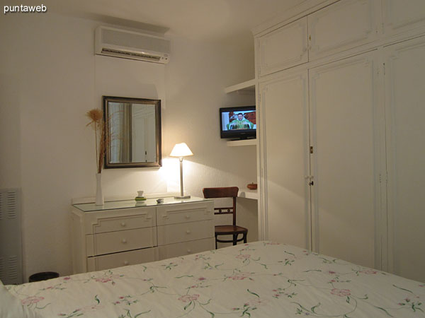 View from the left corner by the head of the bed to the master bedroom closets.<br><br>In the background, the provision of TV and air conditioner.