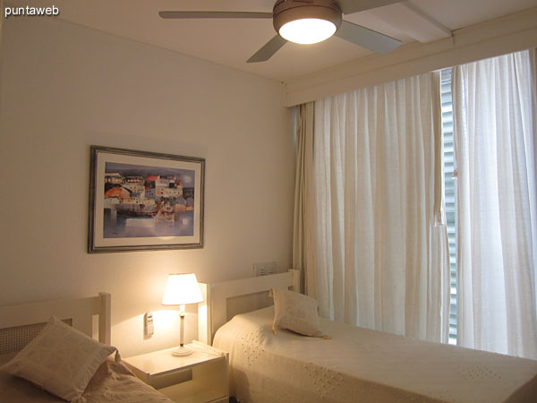 Second bedroom. Located on the east front of the building.<br><br>Conditioning with twin beds and ceiling fan.