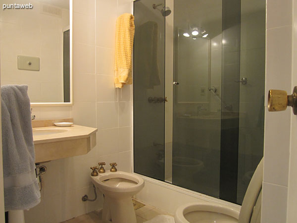 First two bath. Located to the right of the hallway that connects the bedrooms.<br><br>Int. Conditioning with shower stall.
