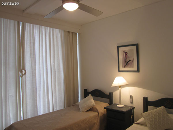 Third bedroom. Located in front of the building to the east.<br><br>Conditioning with twin beds and ceiling fan.