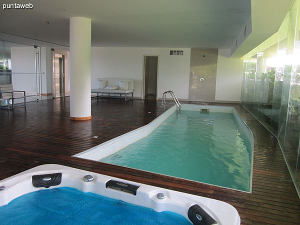 Heated pool in the corresponding to the apartment block. Located on the ground floor next to the lobby.<br><br>It features lounge chairs and a whirl.