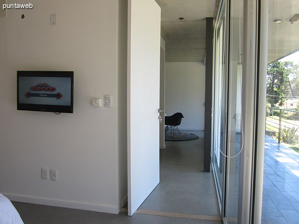 View of the master suite from the head along the closet to the entrance.