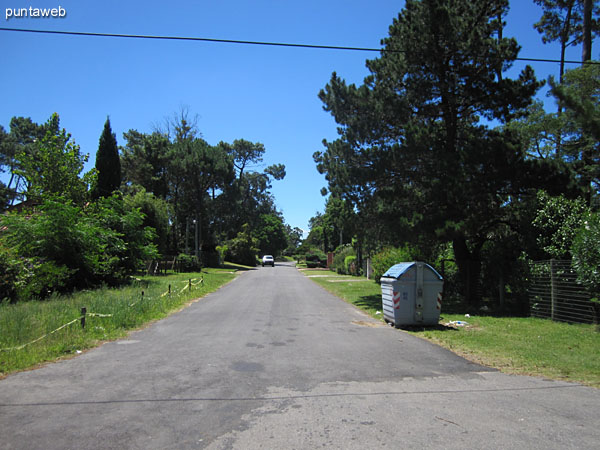 Streets around the building, wooded residential neighborhood.