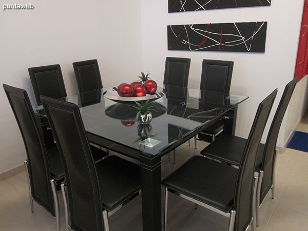 Detail dining space. Equipped with large glass table with eight matching chairs.
