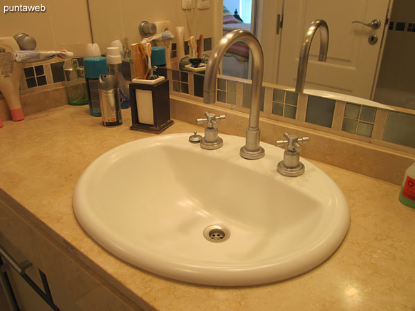 Detail of faucets and fixtures in the bathroom of the suite.