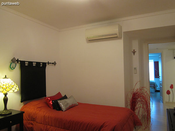 The second bedroom has air conditioning.