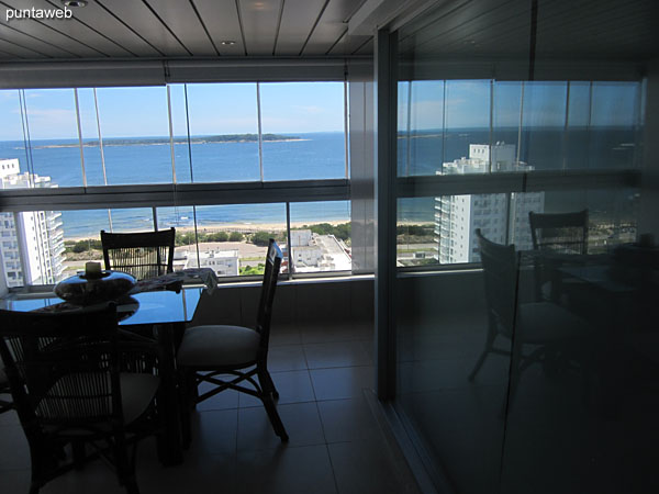 View from the kitchen to the front of the apartment on the enclosed balcony.