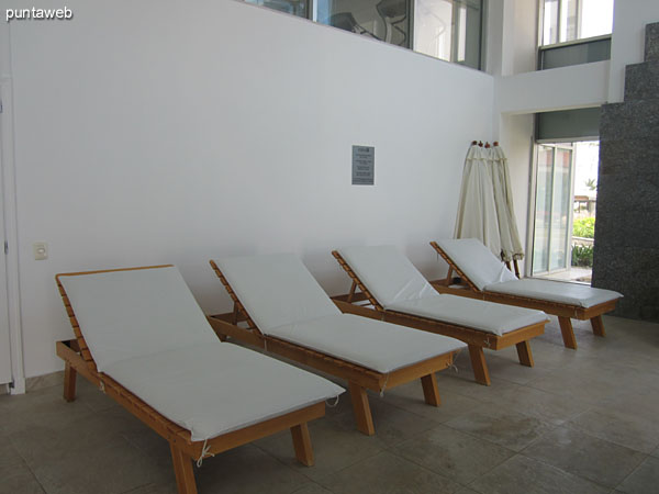 Loungers space in the environment of the heated pool.
