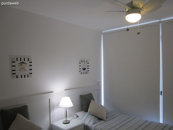 Second bedroom. Located in front terrace with access to the apartment balcony. Equipped with two single beds.