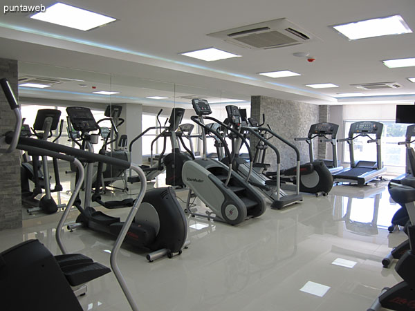 Fitness center. Located in the mezzanine in space surrounding the heated pool. It has all kinds of devices: tapes, stationary bikes and weight machines.