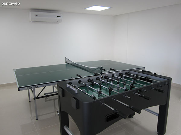 Game room. Located on the ground floor. It has a pool table, foosball, ping pong and tables for card games.