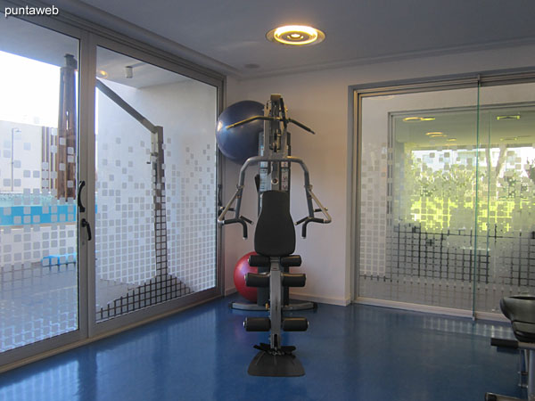 Overview of the gym. Located to the building on the south side. Very bright and well equipped.<br><br>It includes treadmills, stationary bikes and weight machines.