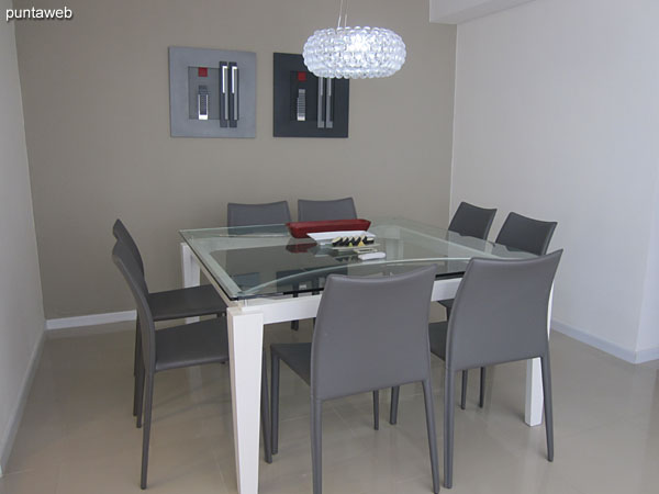 Dining space. Located at the entrance to the living room, next to the kitchen.<br><br>Equipped with square glass and wood table with seating for eight people.