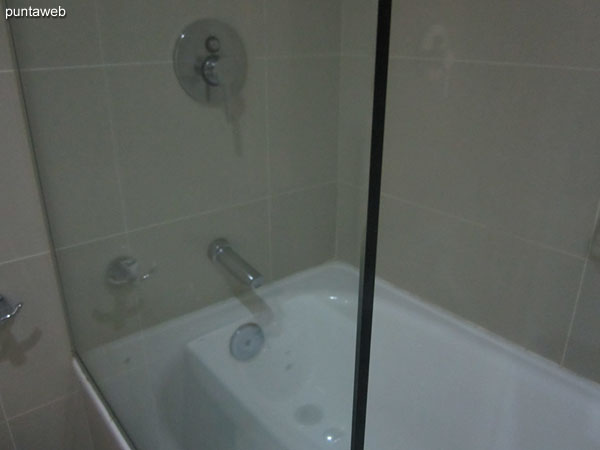 Glass enclosed shower and bathtub in the second bathroom.