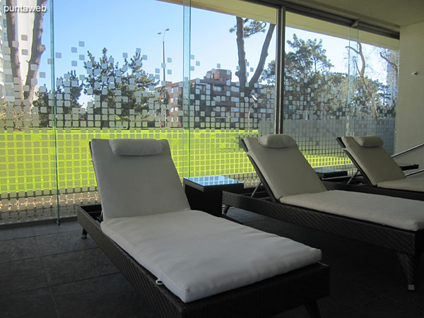 Chairs in the atmosphere of the heated pool.
