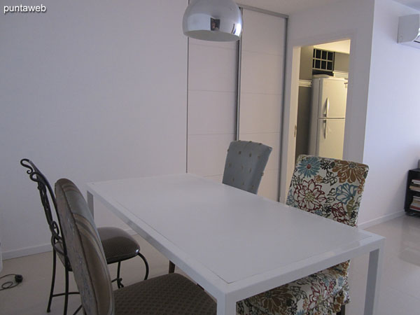 Dining space located the entrance of the apartment. Equipped with rectangular table with four chairs.