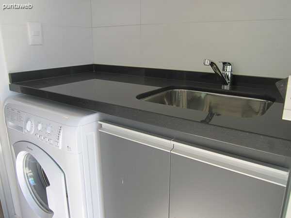 Countertops with stainless steel double sink.