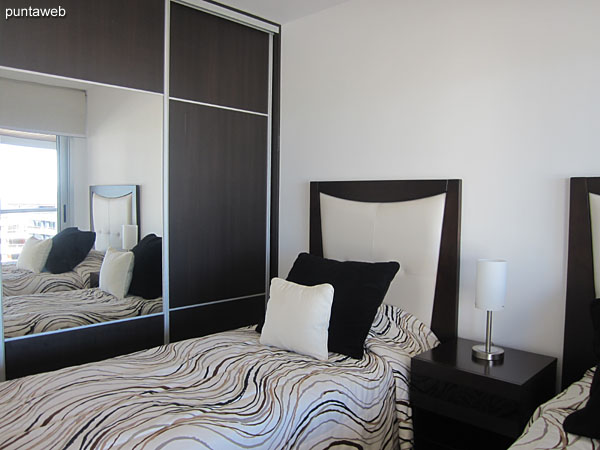 Second bedroom with access to the balcony and sea view.<br><br>Equipped with two single beds.