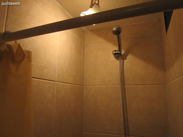 Bathroom in third bedroom suite, exterior.<br><br>Equipped with shower and bath curtain.