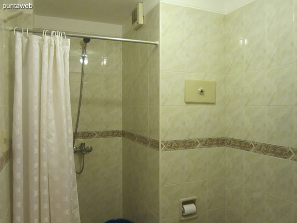 Bath. Inside. Equipped with shower and bathroom curtain.