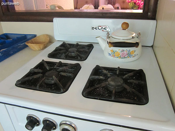 Gas stove with three burners.