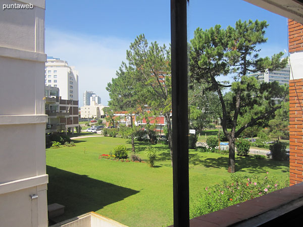 View towards the north side from the window of the living room on the surrounding garden of the neighboring building.