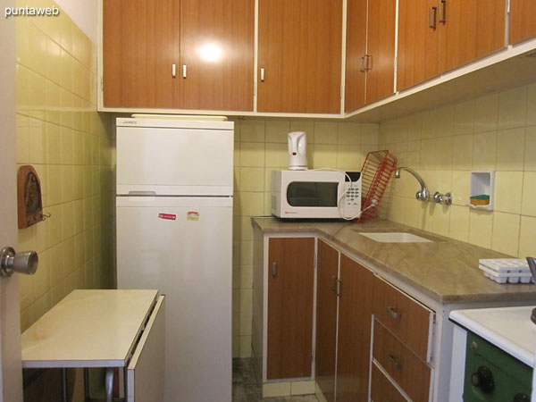 Microwave oven and boiler in the kitchen.