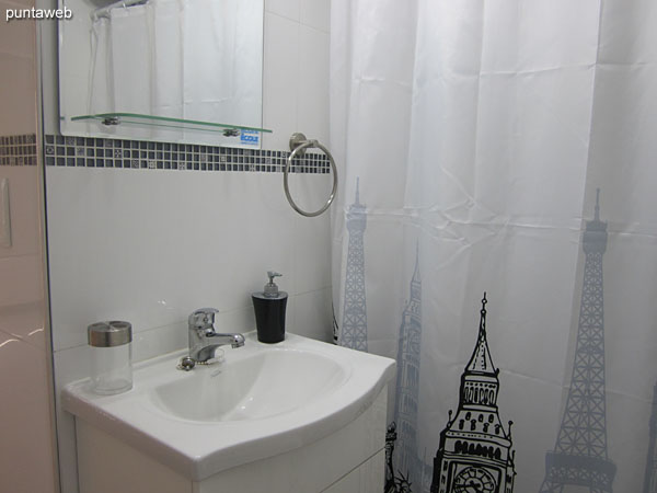 Bathroom interior. It has shower and curtain of bath.
