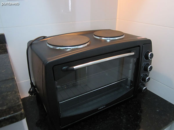 Detail of the digital stove with two burners and electric oven.