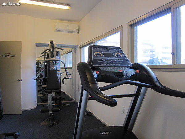 Fitness center. Located in the garage of the building.
