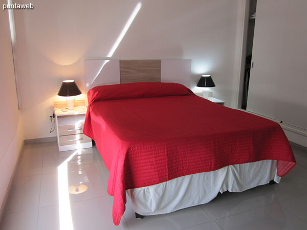 Double bed located towards the south side of the room.