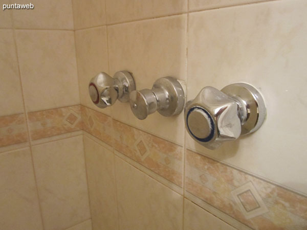 The second bathroom shower has individual controls for hot and cold water.