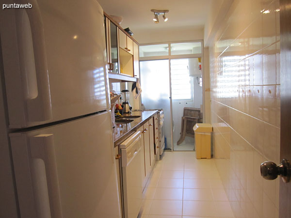 Kitchen, exterior with laundry space.<br><br>It has double bacha counter, furniture and shelves on and under allowance.