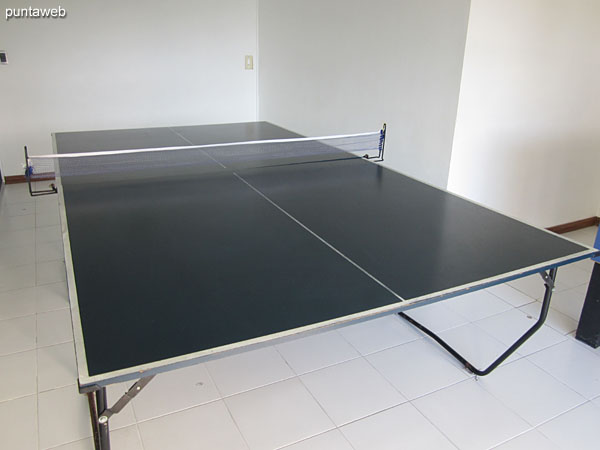 Living room with table tennis table. In this room there is also a football.
