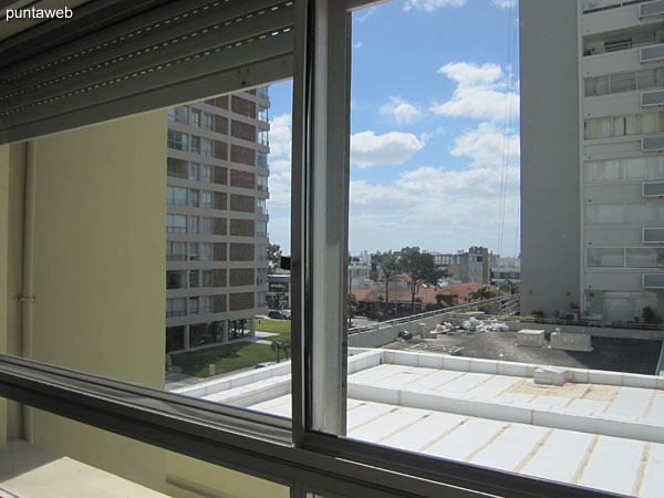 View from the window of the living room towards the northeast on the surroundings of a neighboring building.