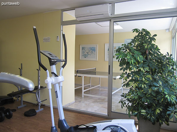 Gym, located on the first floor. It has tape, fixed bicycle and weight systems.