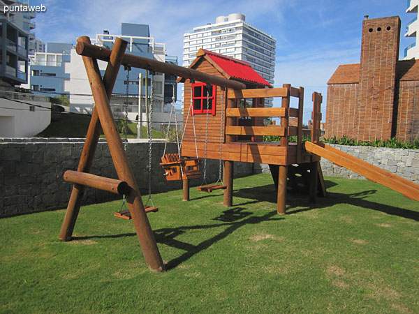 Space for children to play in the garden of the building.