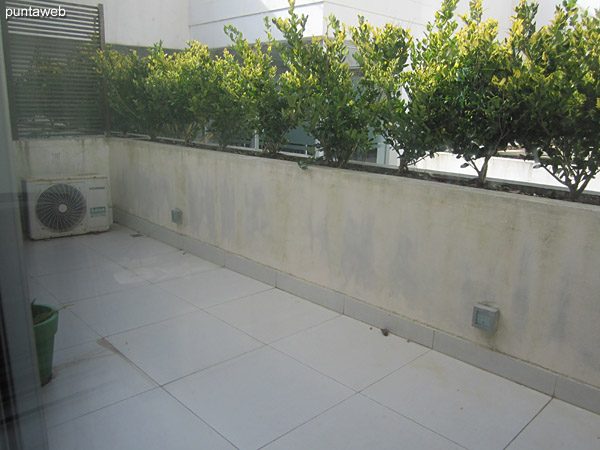 Balcony terrace accessible from living room and bedroom. It has a square table with four chairs.