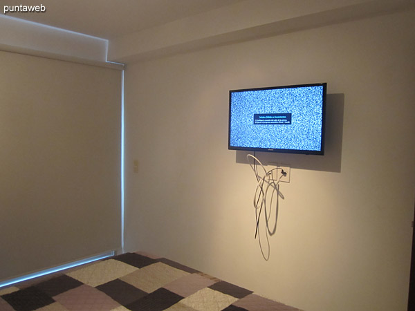 TV with cable in the bedroom.